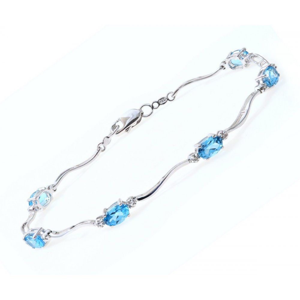 Sterling Silver Bracelet Set With Blue Topaz Gem Stone And